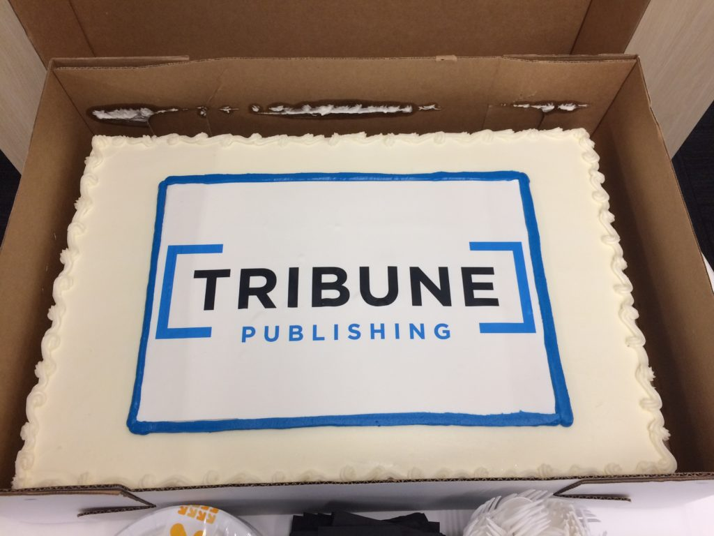 The Tribune Publishing logo cake