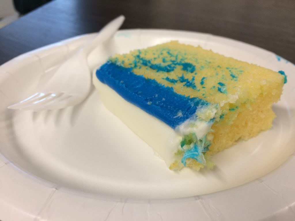 Slice of the Tribune Publishing logo cake